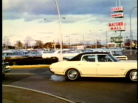 montage, parking lot at macomb mall, 1960's, detroit, michigan, usa - 1960 1969 stock-videos und b-roll-filmmaterial