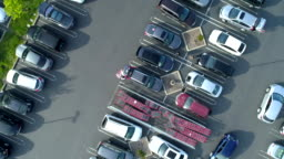 Parking lot at shopping plaza. Drone point of view.