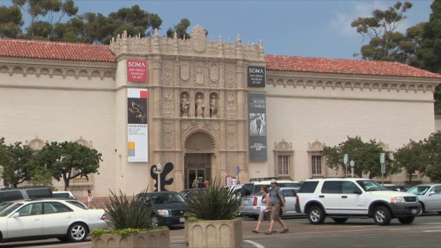 ms parking lot outside museum of art, balboa park, san diego, california, usa - museum stock videos & royalty-free footage