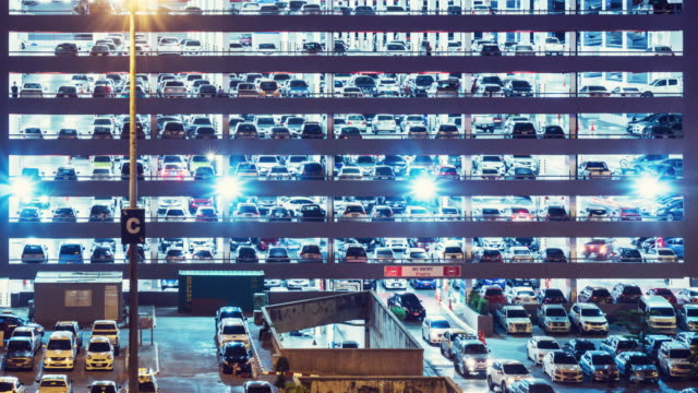 parking lot time lapse at night - parcheggio video stock e b–roll