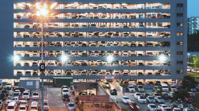 parking lot time lapse , panning right. - organization stock videos and b-roll footage