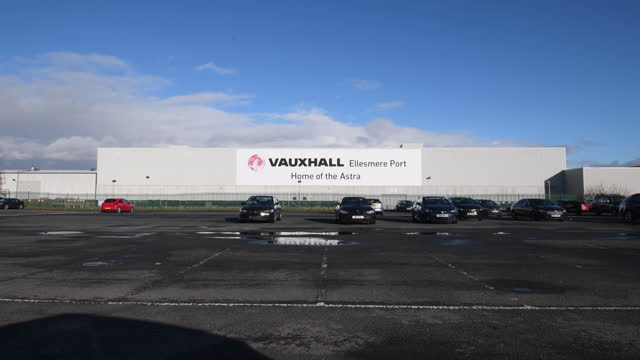 parking lot with few cars parked in front of vauxhall plant in ellesmere port. stellantis nv, the owner of vauxhall and opel plants in the u.k., will... - anticipation stock videos & royalty-free footage