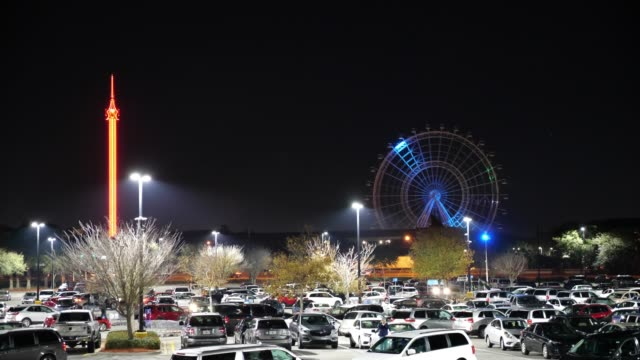 parking lot with icon orlando in the background at night - parking lot stock videos & royalty-free footage