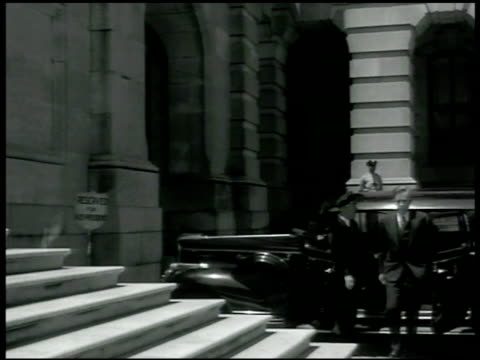 stockvideo's en b-roll-footage met parking shield sign 'reserved for vicepresident' vicepresident henry a wallace getting out of chauffeur driven car walking up capitol building steps... - 1942