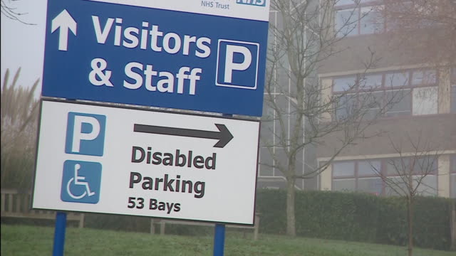 parking signs at an nhs hospital - road sign stock videos & royalty-free footage