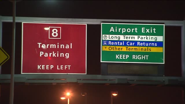 parking signs at jfk airport at night at john f. kennedy international airport on november 22, 2013 in new york, new york - kennedy airport stock videos & royalty-free footage