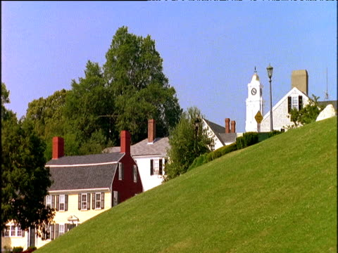 Parkland and houses in traditional pilgrim settlement town Plymouth USA