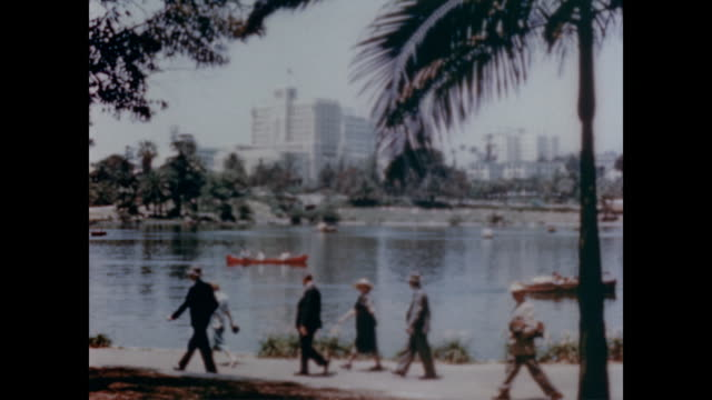 1947 parks of los angeles including pershing square, crowded with people enjoying the sun - 1947年点の映像素材/bロール