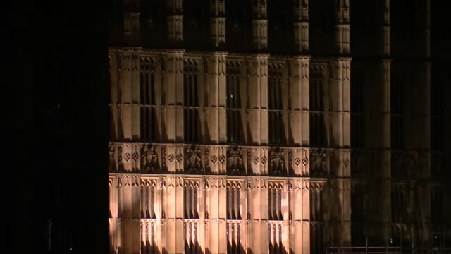 stockvideo's en b-roll-footage met parliament at night general views; england: london: westminster: lambeth bridge: ext / night various shots of palace of westminster, seen from... - victoria tower