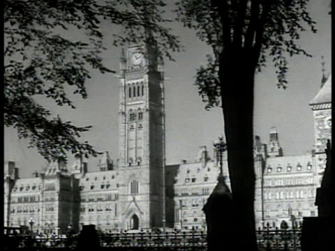 parliament hill building ottawa int ha ws prime minister mackenzie king at head of round table in cabinet meeting ms king at table w/ papers wwii... - ottawa stock-videos und b-roll-filmmaterial