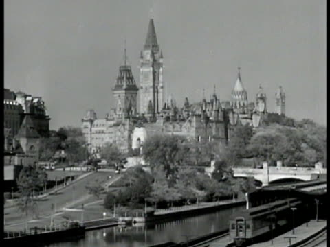 parliament hill ottawa ha ws city buildings streets traffic ms newsstand on street pedestrians la ws chateau frontenac town life fg quebec - parliament hill stock videos and b-roll footage