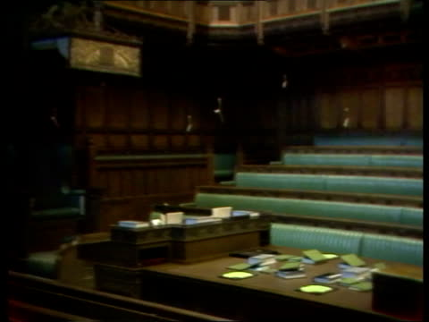 stockvideo's en b-roll-footage met tv parliament itn lib gv houses of parliament from embankment zoom ts interior chamber of house of commons ms speaker's chair in chamber of house of... - house of commons