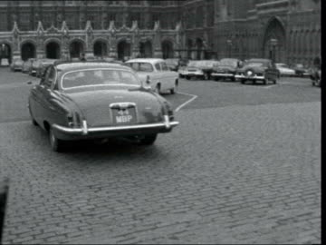 stockvideo's en b-roll-footage met parliament pays tribute to kennedy; england: london: house of commons: ext harold macmillan's car - into bv flag at half mast on victoria tower -... - victoria tower