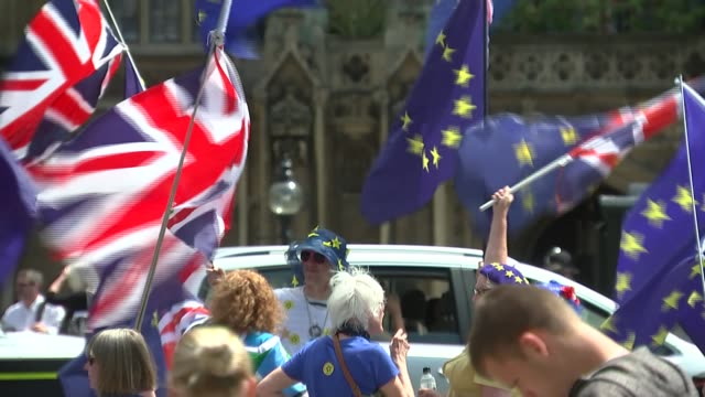 parliament square anti-brexit protest; england: london: westminster: parliament square: ext gvs pro-eu protesters with eu flags - rebellion stock videos & royalty-free footage