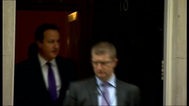parliament votes in favour of air strikes against islamic state in iraq england london downing street ext david cameron mp form number 10 and into car - isis stock videos and b-roll footage