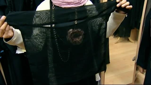 vídeos de stock, filmes e b-roll de parliament votes to ban muslim women wearing burqas in public england lancashire blackburn int women trying on hijab and burka in muslim clothes shop... - vestimenta religiosa