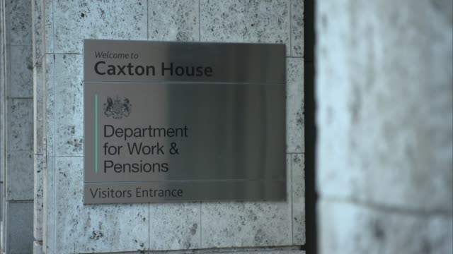 parliamentary committee says government ignoring 'unacceptable hardship' caused by universal credit rollout england london ext gvs department for... - credit union stock videos & royalty-free footage