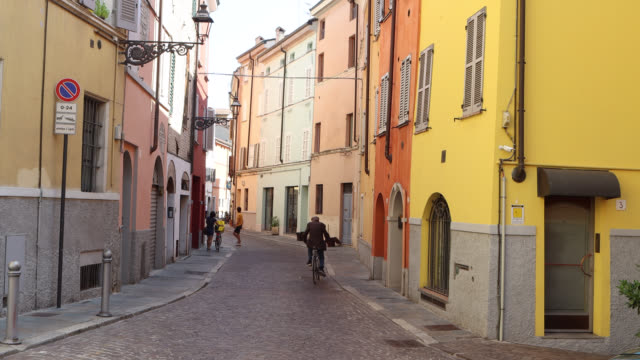 parma street with bicycles and pedestrians - italy stock videos & royalty-free footage
