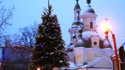 Parnu, Estonia. Christmas Tree In Holiday New Year Festive Illumination And St. Katherine Orthodox Church On Background