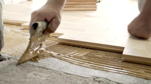 parquet floor installation - installing stock videos & royalty-free footage