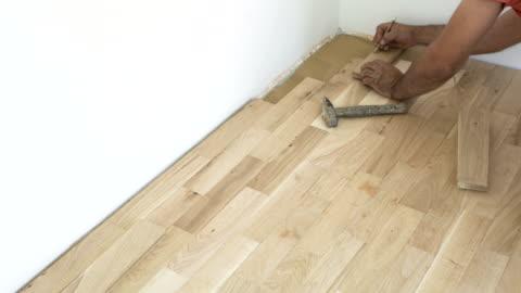 parquet floor installation - flooring stock videos & royalty-free footage