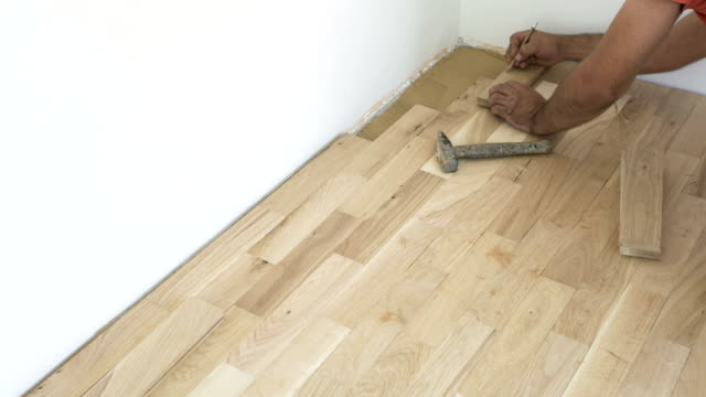 parquet floor installation - diy stock videos & royalty-free footage