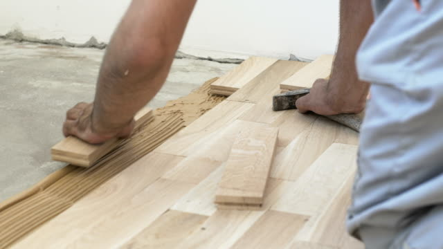 parquet floor installation - restoring stock videos and b-roll footage