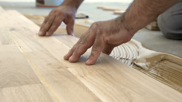 parquet flooring installation - repairman stock videos & royalty-free footage