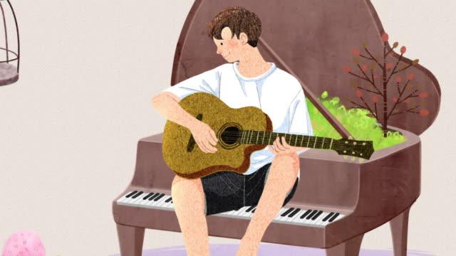 vídeos de stock, filmes e b-roll de parrot and young man playing guitar while sitting at the piano - dedilhando instrumento