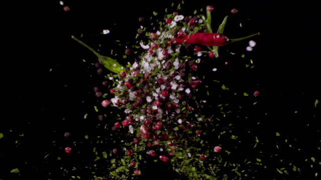 parsley, peppercorns, bay leaves, oregano, sea-salt, chili pepper, rosemary colliding in the air super slow motion video 1000 fps - spice stock videos & royalty-free footage