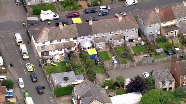police make two further arrests lib / tx sunburyonthames house with cavendish road police barrier visible forensic tent in garden - festnahme stock-videos und b-roll-filmmaterial