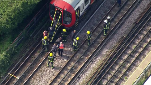 Ahmed Hassan convicted of attempted murder R150917002 / 1592017 ENGLAND London Parsons Green Firefighters helping passengers to escape from the...