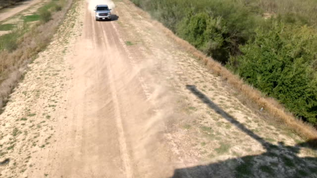 Part 3 A pickup races away during a highspeed chase while being pursued by Texas state troopers and a US Customs and Border Protection helicopter on...