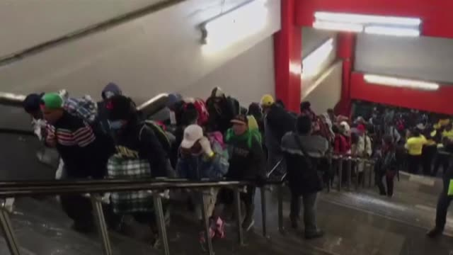 part of a central american caravan of migrants take the metro in mexico city as they persevere toward the us border after leaving behind a shelter in... - mexican american stock videos & royalty-free footage