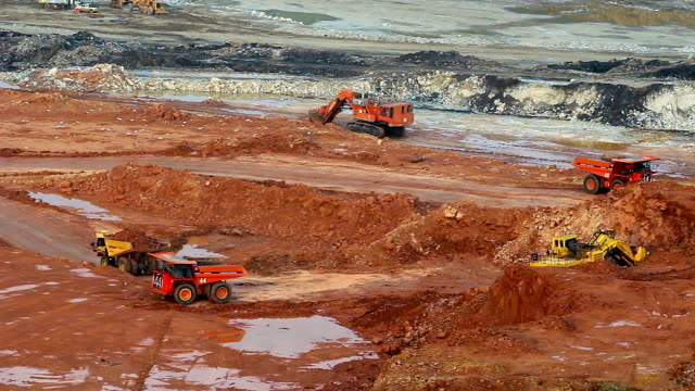 part of a pit with big mining truck working - metal ore stock videos & royalty-free footage