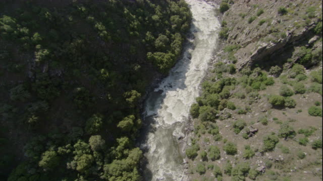 Part of California's Kings River flows fast, creating whitewater. Available in HD.