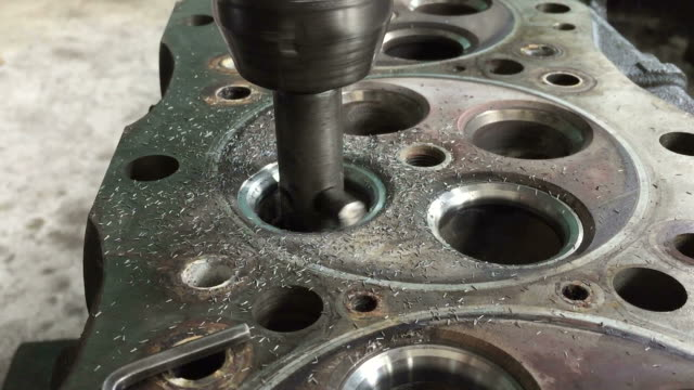 part of car engine, four valve in head for each cylinder.machining valve seat. - anatomical valve stock videos and b-roll footage