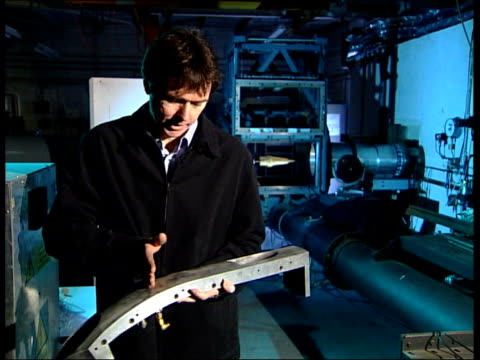 vídeos de stock e filmes b-roll de part of hypersonic engine built for hyshot held cms terry cain interview sot hampshire: farnborough: cms part of rocket in wind tunnel ext sign... - hampshire