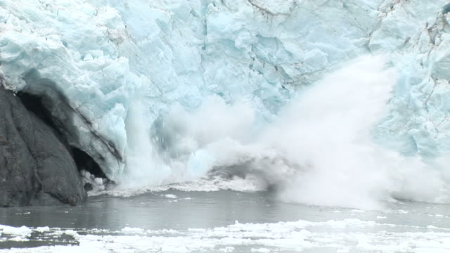 part of portage glacier falls into the lake. - glacier stock videos & royalty-free footage