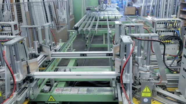 part of production line in window frame industry - window frame stock videos and b-roll footage