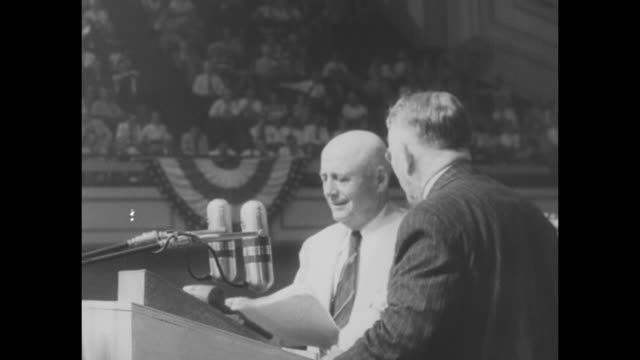 [Part of retrospective of Harry Truman's career] title superimposed on Harry S Truman and Alben Barkley 'Truman Barkley nominated' / VS huge crowd of...