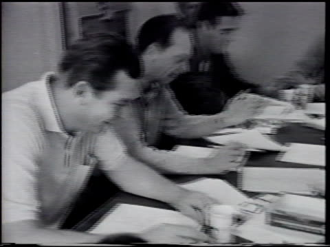 Part of television sitcom cast of The Andy Griffith Show at table w/ scripts PAN Table Andy next to Don Knotts Jack Burns unidentified male Howard...