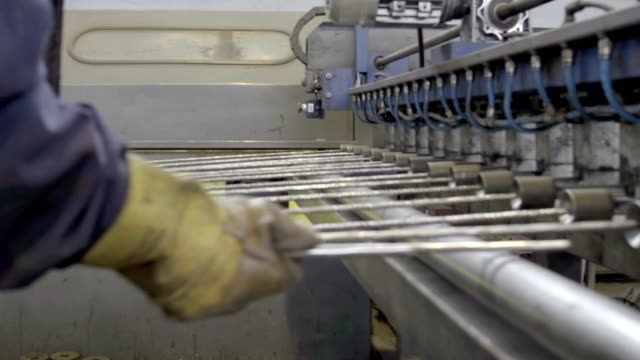 part of the machine for welding wire mesh in action - hydraulics stock videos and b-roll footage
