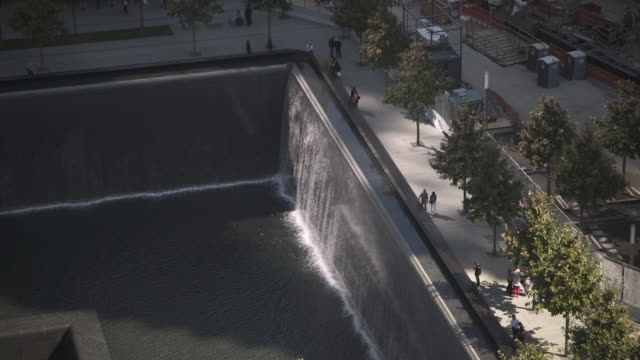 part of the national september 11 memorial - 'reflecting absence' - in manhattan, new york city, usa. - september 11 2001 attacks stock videos & royalty-free footage