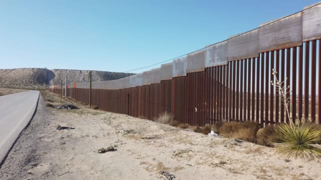 part of the u.s. border wall is seen on january 13, 2019 in ciudad juarez, mexico. the u.s. government is partially shutdown as president donald... - government shutdown stock videos & royalty-free footage