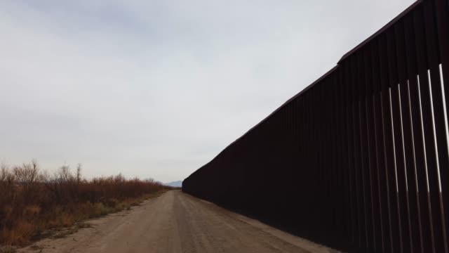part of the u.s./mexico border wall is seen on january 14, 2019 in fort hancock, texas. the u.s. government is partially shut down as president... - government shutdown stock videos & royalty-free footage