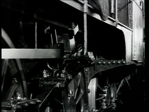 1913 montage b/w cu part of train on the trans siberian railway/ ws train pov emerging from tunnel for inauguration ceremony of section of the trans siberian railway/ russia - lokomotive stock-videos und b-roll-filmmaterial