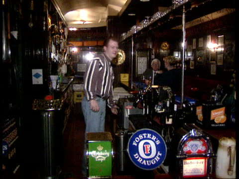 london clerkenwell the griffin pub ms aidan nolan working behind bar cms aidan nolan interview sof no holiday pay or sick pay for part time workers - griffin stock videos & royalty-free footage