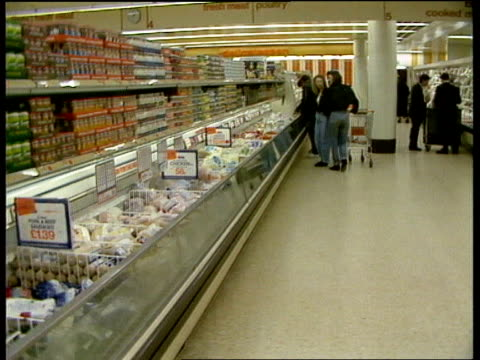 londonsainsbury's bv men in suits handling food packets out shoppers in supermarket ms cashier at checkout pull out more ms elderly man pushing row... - sachet stock videos & royalty-free footage