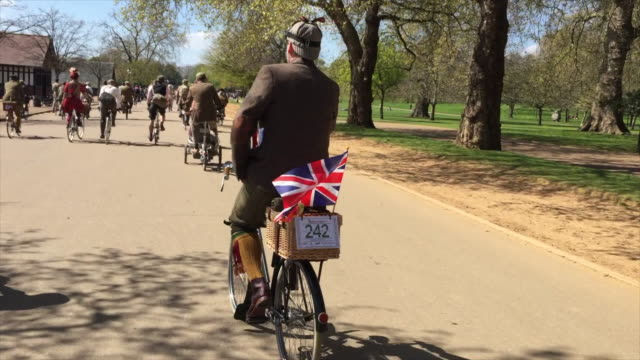 part two of a short film about the tweed run as it passes through london on a glorious spring morning. - attending stock videos & royalty-free footage